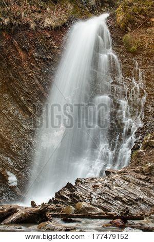 High mountain stream water in rock stone