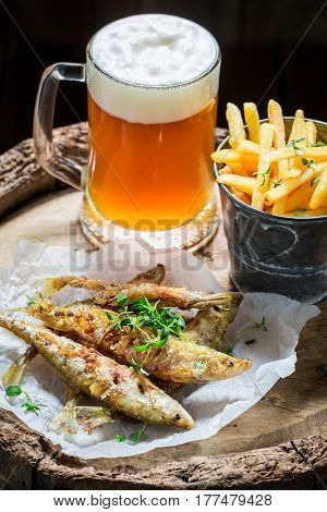Delicious Roasted Smelt Fish With Cold Beer