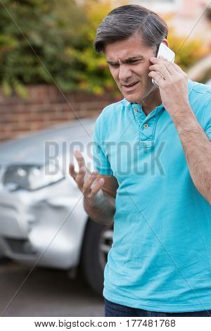 Mature Man Calling To Report Car Accident