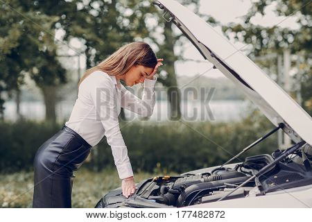 two girls on the road trying to fix their car