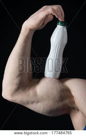 Male Hand Of Muscular Man With Biceps, Triceps, Drink Bottle