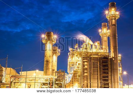 Aerial view oil refinery night background during twilight,Industrial zone,Energy power station.,Petrochemical plant at twilight