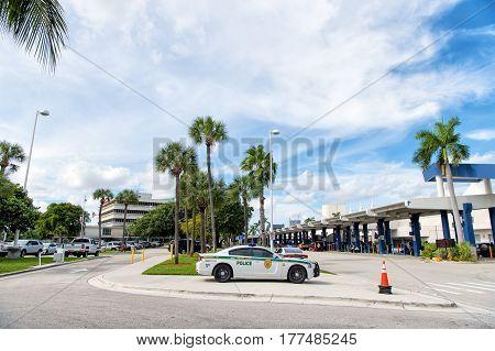 Police Car, 911 Auto On Sidewalk Road, Miami, Florida
