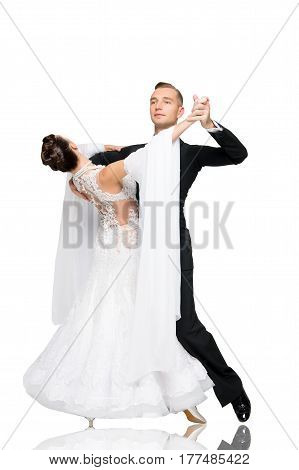 beautiful ballroom dance couple in a dance pose isolated on white background. sensual proffessional dancers dancing walz tango slowfox and quickstep