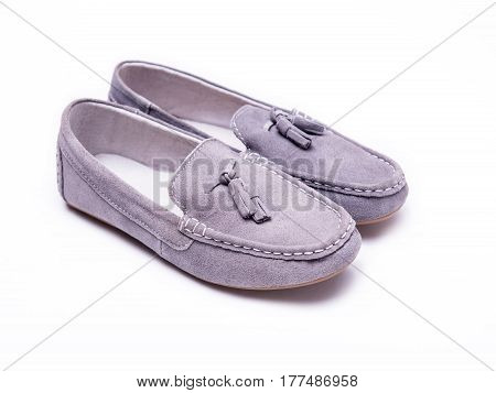 Moccasins of suede on a white isolated background