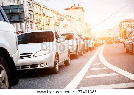 View from below to cars in a queue in traffic jam