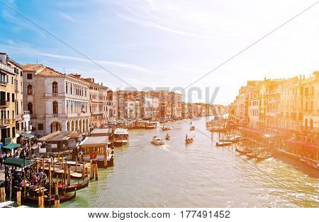 Panoramic view of famous Grand Canal Also visible are various local transport restaurants coffee shops and Venetian traditional architecture as seen from Rialto Bridge Italy