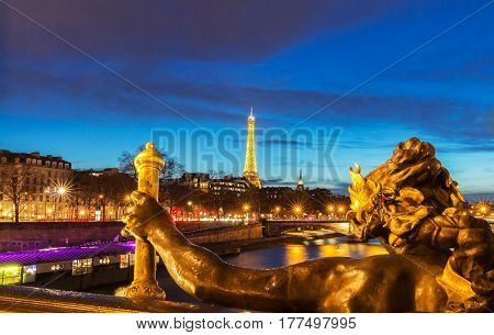 Paris France - March 04 2017: Seine river and Eiffel Tower seen pont Alexandre III . Eiffel Tower is the French most visited monument and use 20000 light bulbs in the show.