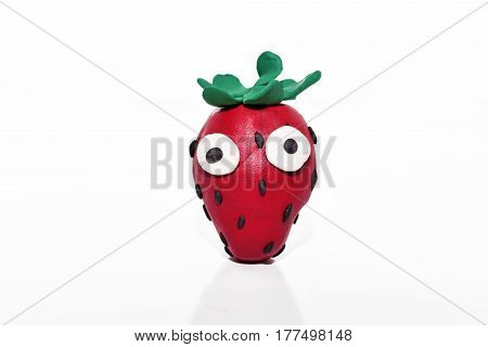 Strawberry made from plasticine. Isolated on white background.