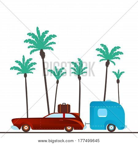 Vintage camping car against the backdrop of palm trees.