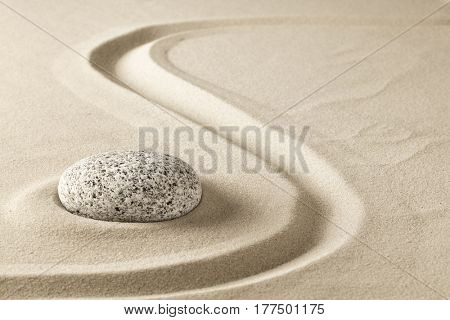 zen meditation stone in sand. Concept for purity harmony and spirituality. Spa wellness and yoga background.