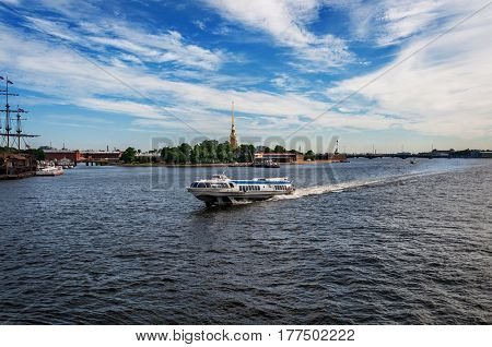 River channel with boat in and view Peter and Paul Cathedral in Peter and Paul Fortressof Saint-Petersburg.