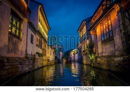 SHANGHAI, CHINA - 29 JANUARY, 2017: Beautiful evening light creates magic mood inside Zhouzhuang water town, ancient city district with channels and old buildings, charming popular tourist area.