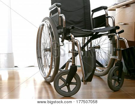 Wheelchairs To Disabled People In A Bedroom