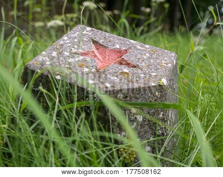 A Russian red star on a pedestal on a forgotten cemetery of Soviet soldiers in Wolka Weglowa on the