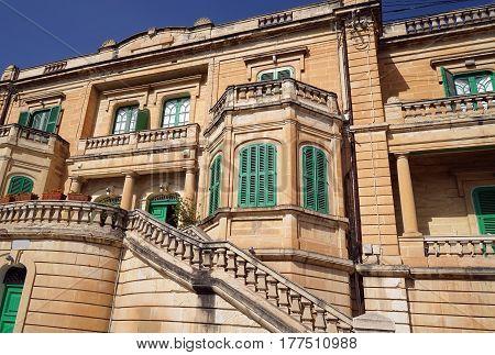 Facade of a classical villa on the Malta. Typical Maltese villa facade.