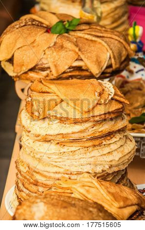 A huge stack of pancakes while celebrating Russian Shrovetide (pancake week)