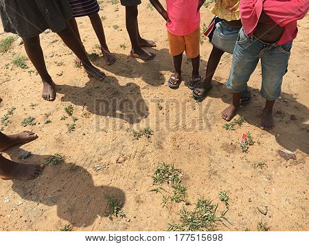 Poorness and poor children in Swaziland.Naked feet. Africa