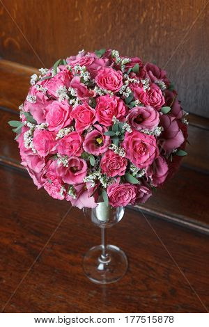 Magenta wedding bouquet of spray roses and eustoma (lisianthus) flowers