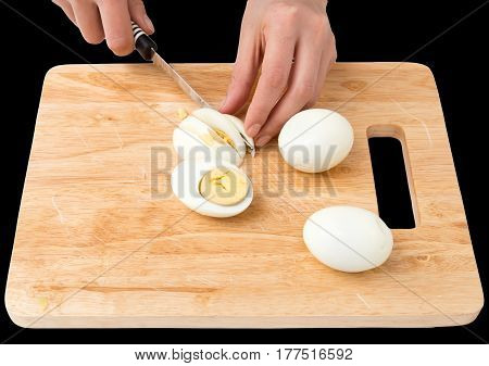 cook eggs on cutting board on a black background .