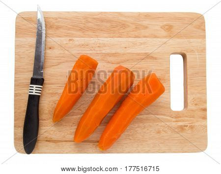 carrots on a board on a white background .