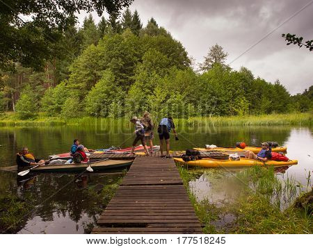 River Wda Poland - August 23 2016: A break at a pier during canoeing excursion