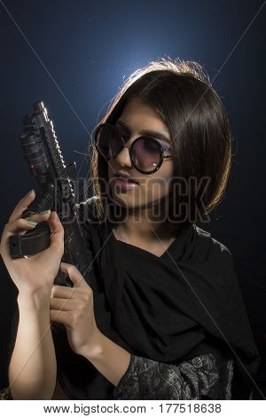 Young girl with glasses posing as bad girl