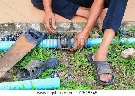 plumber cut with saw repair plumbing broken pipe