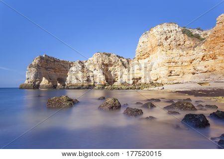 Long exposure at the cliffs in Marinha beach, Algarve Portugal