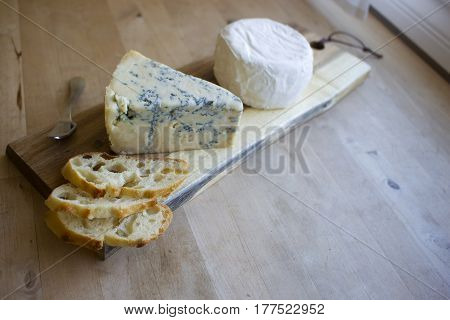 A cheese board with two different cheeses.