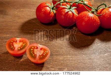 fresh ripe cherry tomatoes on wooden background salt free space