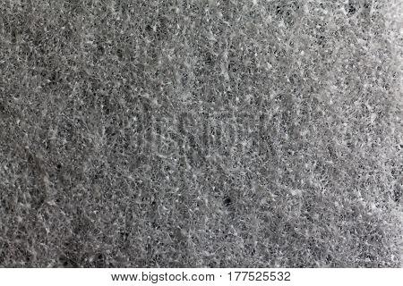 A macro photo of grey foam rubber as background