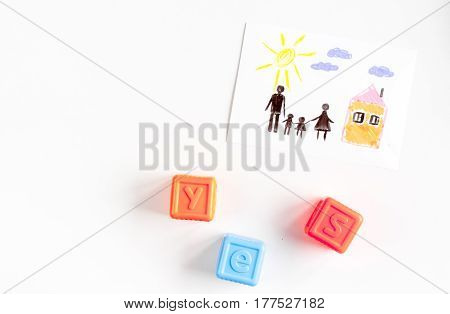 happy family concept with toys and drawing on white desk background top view mock up