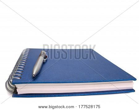 pen and book placed on a white background.