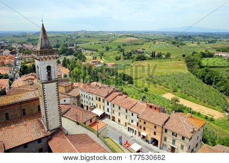 Travel To Vinci, Italy. The View On The City With Red Roofs And Fields Of Toscana.