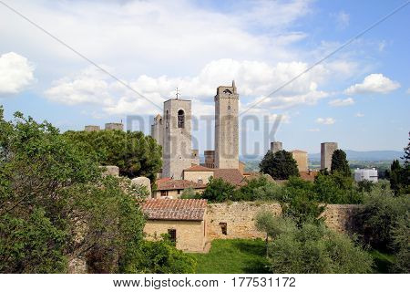 Travel To San Gimignano, Italy. The View On The City With The Ancient Buildings.