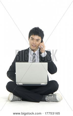 man in suit on cell phone looking happy and laughing