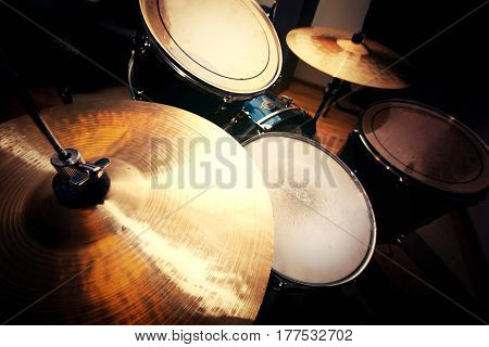 Drums conceptual image. Picture of drums and drumsticks lying on snare drum.