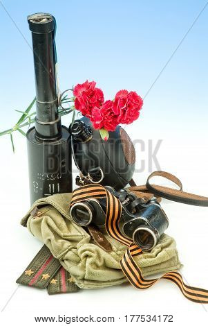 Flowers and army equipment on a studio background