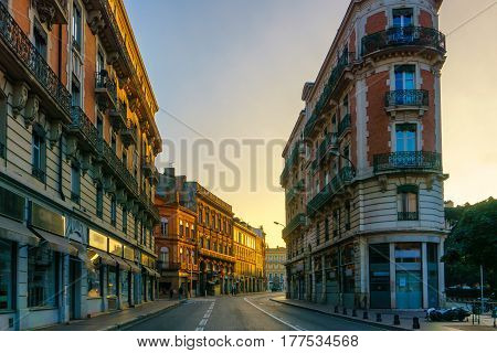 Narrow historic street with old buildings in Toulouse France