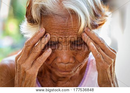 Age Vision and old people concept - Close up of senior asian woman face and eye Asian senior woman with sinusitis (sinusitis)