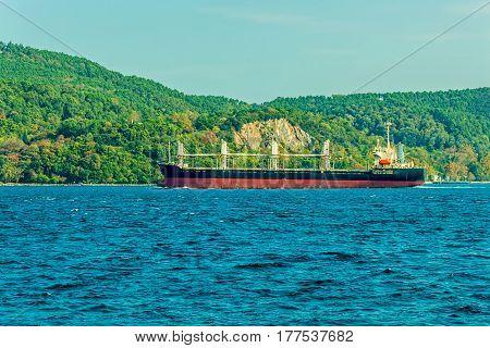 The ship sails Bosphorus on sunny autumn day.