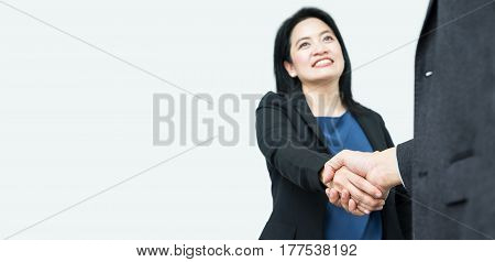 Smile Business Woman Handshake With Businessman,focus On Hand,mock Up Banner For Adding Your Text Or