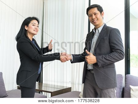 Smile Business Woman And  Business Man Shaking Hand And Thumb Up In Office ,partnership Agreement Co