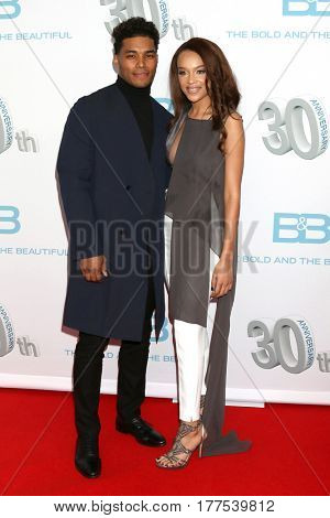 LOS ANGELES - MAR 19:  Rome Flynn, Reign Edwards at the