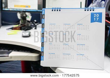 close up 2017 calendar on messy office desk