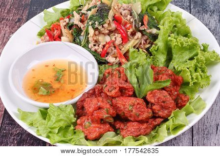 Fried Spicy Basil With Minced Pork And Curried Fish Cake.