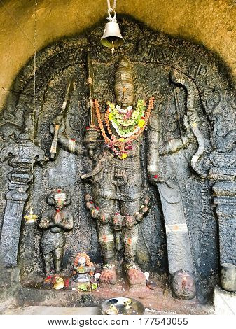 Lord Veerabhadra statue engraved in rock at Shivagange temple near Bangalore, India captured on March 19th, 2017