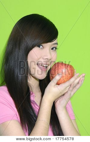 Young woman holding a apple