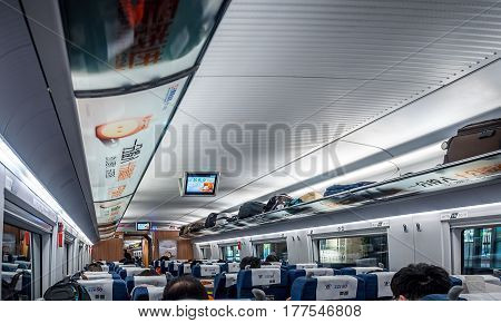 Beijng, China - Oct 31, 2016: Modern interior cabin design of the China High-Speed Rail. Economy class. Layout resembles that of an aircraft cabin.